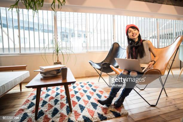 young female start up business woman talking with colleague in office - femme japonaise belle photos et images de collection