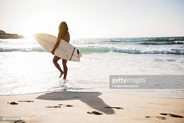 Young female surfer