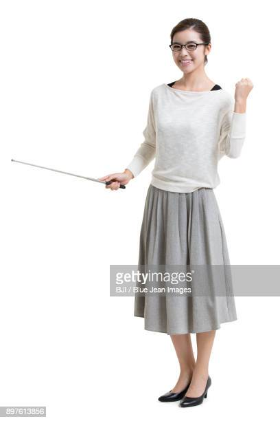 Young female teacher with teachers pointer cheering