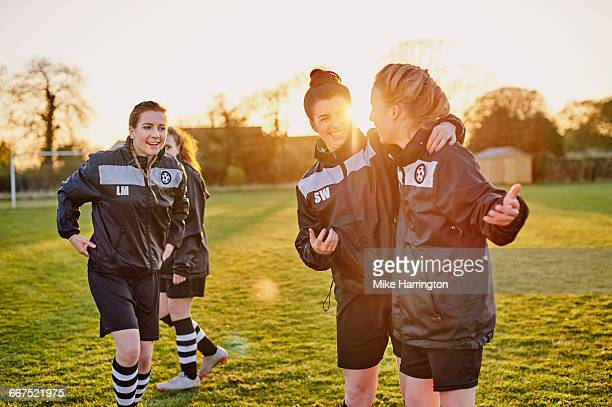 young female team mates at football training - leanincollection stock pictures, royalty-free photos & images