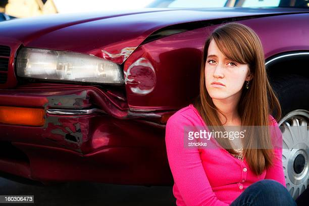 Young Female Teenager Reacts with Defiance to Bent Fender Accident