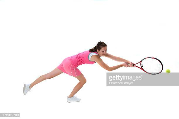 Young female tennis player in action