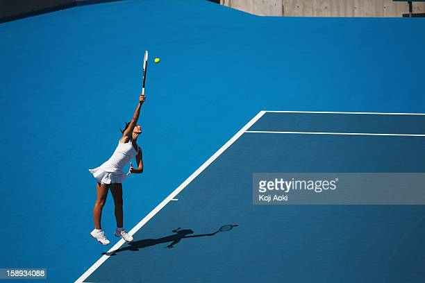 young female tennis player - hardcourt stock photos and pictures