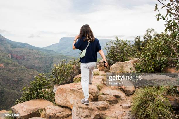 young female tourist exploring the three rondavels, mpumalanga, south africa - mpumalanga province stock pictures, royalty-free photos & images