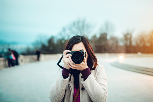 Young female tourist taking pictures on the top of the Mont Royal park - gettyimageskorea