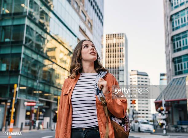 young female tourist travel explore city in wellington new zealand - new zealand stock pictures, royalty-free photos & images