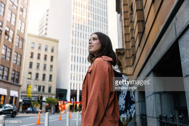 young female tourist travel explore city in wellington new zealand - wellington new zealand stock pictures, royalty-free photos & images
