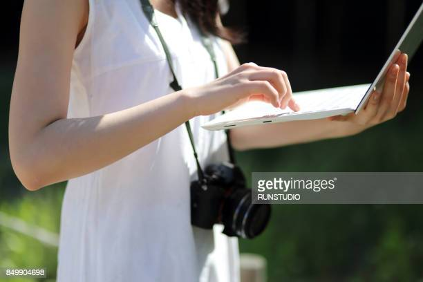 young  female tourist using laptop - mid section stock pictures, royalty-free photos & images