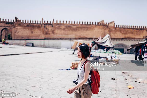 Young female tourist walking in an old town