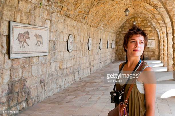 young female tourist with camera at beiteddine palace in lebanon - lebanon stock pictures, royalty-free photos & images
