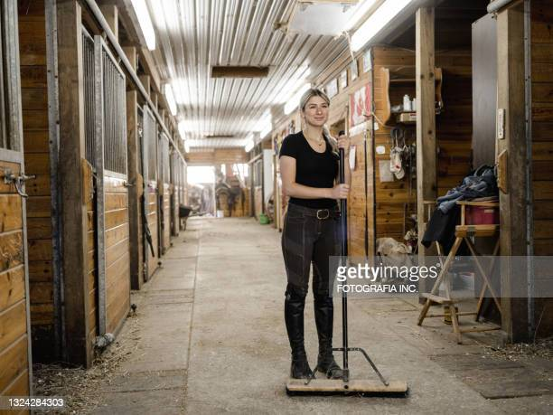 young female trainer doing chores - chores stock pictures, royalty-free photos & images