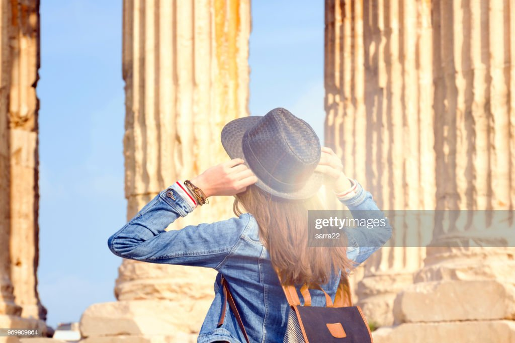 Young female traveler in back. : Stock Photo