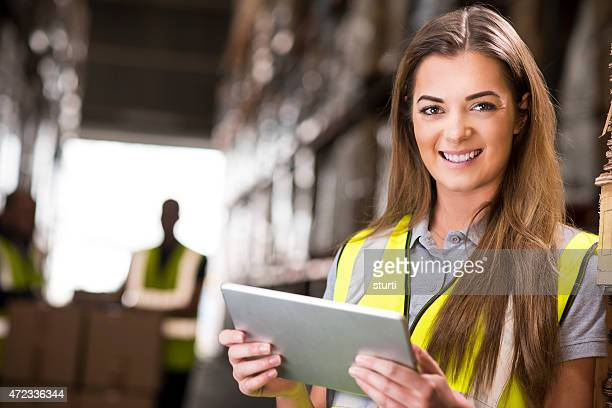 young female warehouse checking her deliveries