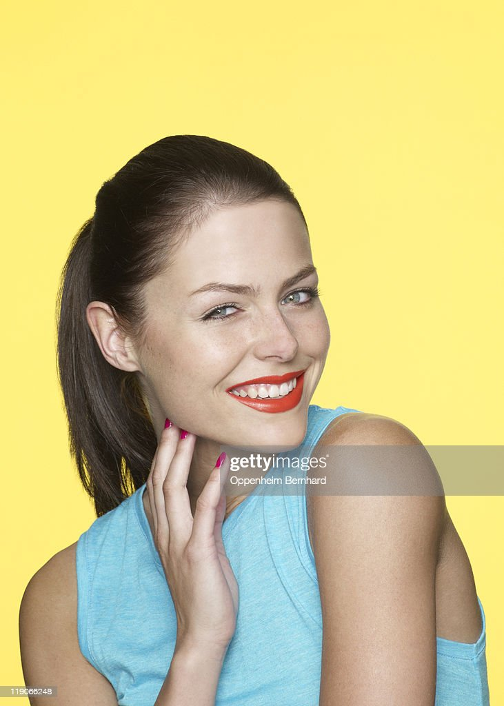 a1e44b339354 Young Female Wearing A Blue Vest And Blushing Stock Photo | Getty Images