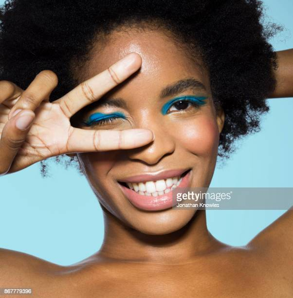 young female wearing blue eye make-up - eye liner stock pictures, royalty-free photos & images