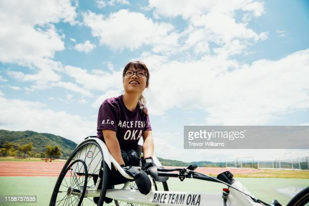 Young female wheelchair racer before a competition at a track and field event