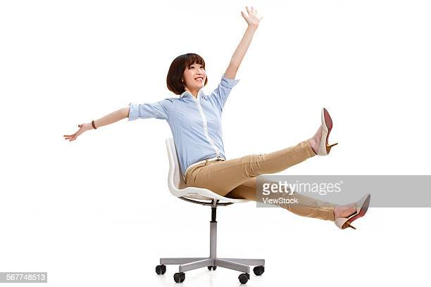 Young female white-collar workers sitting in a chair