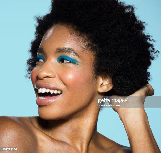 young female with blue eye make-up - eye liner stock pictures, royalty-free photos & images