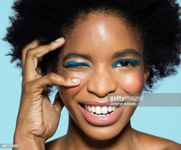 young female with blue eye make-up - headshot stock pictures, royalty-free photos & images