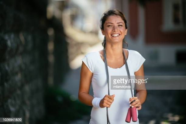 young female with skipping rope - skipping along stock pictures, royalty-free photos & images