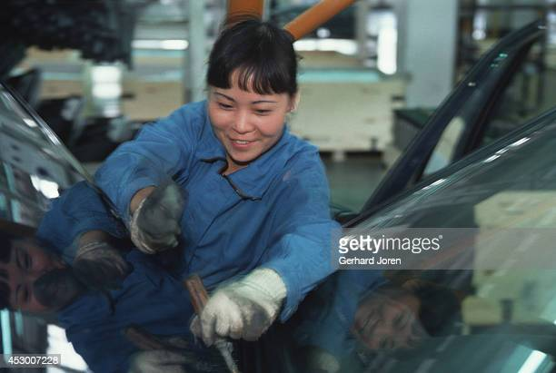 A young female worker on the assembly line at Shanghai Volkswagen Automotive Company Ltd assembly plant Here they produce the Santana model for the...