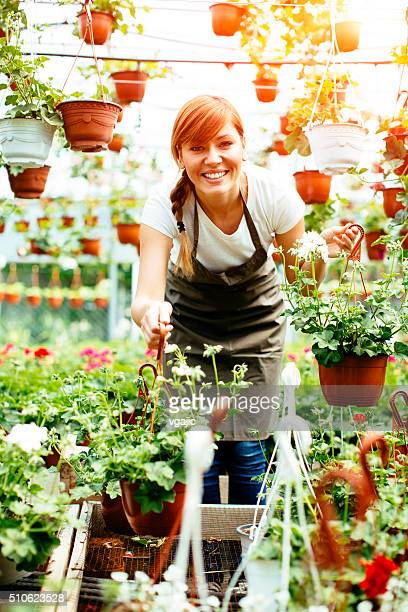 Young Female Working At Plant Nursery