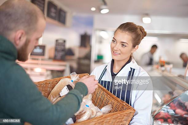 young female working at the deli