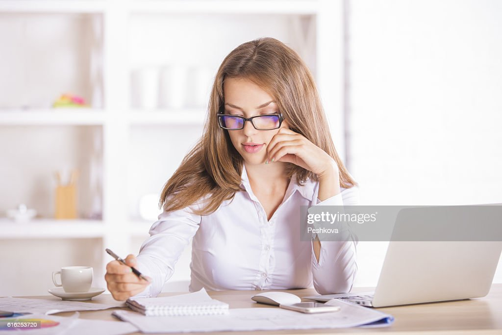 Young female working on project : Stock Photo