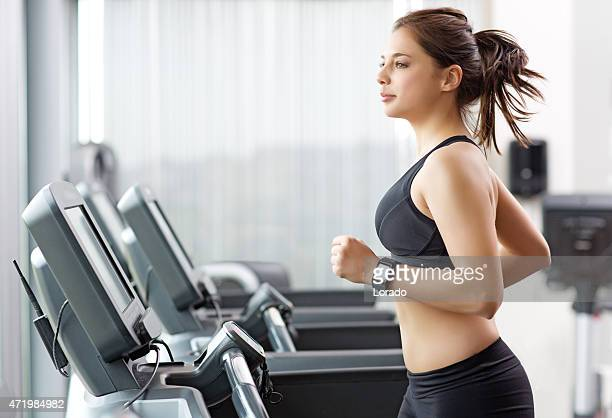 Young female working out at a gym
