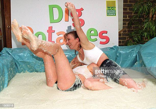 Young female wrestlers get down and dirty during a mashed potato wrestling match courtesy of the British Potato Council October 9 2000 in London...