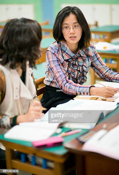 Young females discussing in classroom