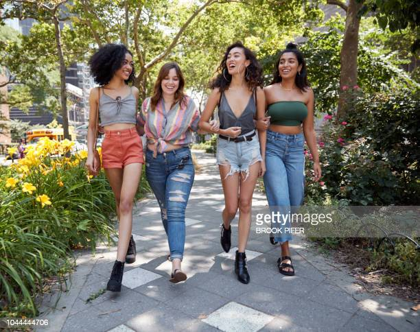 young females hanging out in city - black pants stock pictures, royalty-free photos & images