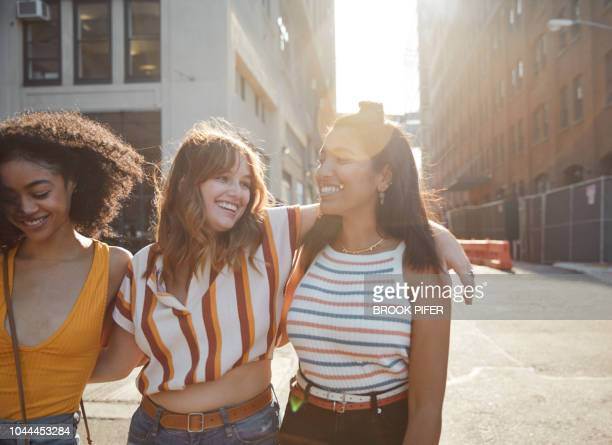 Young females hanging out in city