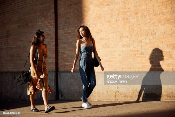 young females hanging out in city - beige dress stock pictures, royalty-free photos & images
