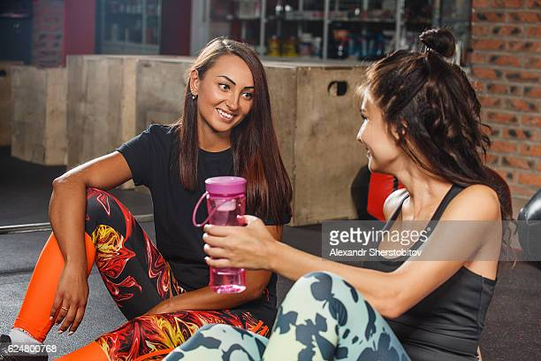 Young females having a break after workout