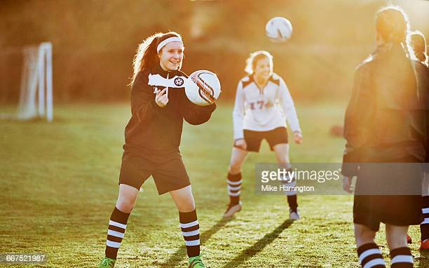 Young females in football training