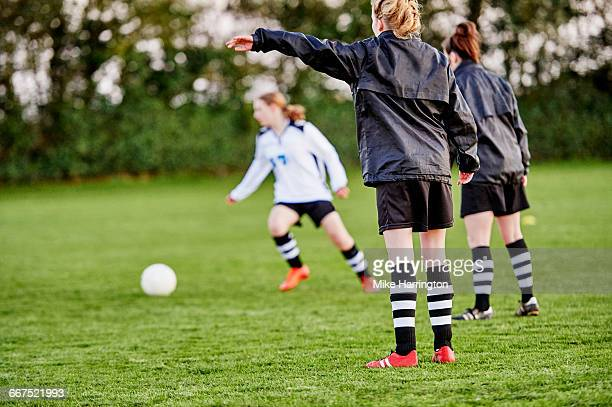 Young females playing football