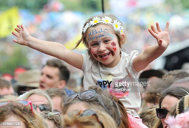 A young festival goer waits for Lionel Richie to perform live on the Pyramid stage during the third day of Glastonbury Festival at Worthy Farm Pilton...