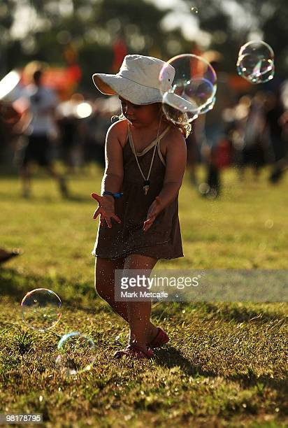 A young festivalgoer plays with bubbles onsite during the first day of Bluesfest 2010 at Tyagarah Tea Tree Farm on April 1 2010 in Byron Bay Australia