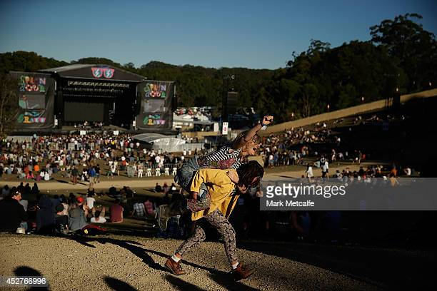 Young festivalgoers dance around at the amphitheatre at Splendour In the Grass 2014 on July 27 2014 in Byron Bay Australia