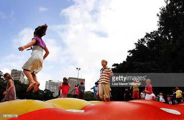 Young festivalgoers enjoy Reve de Grenouilles inflatable paradise during the opening day for the 2008 Sydney Festival in Hyde Park on January 5 2008...