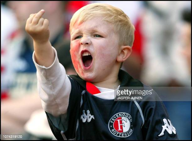 A young Feyenoord Rotterdam supporter gives the bird during the UEFA Cup final match against Borussia Dortmund in Rotterdam 08 May 2002 AFP PHOTO...