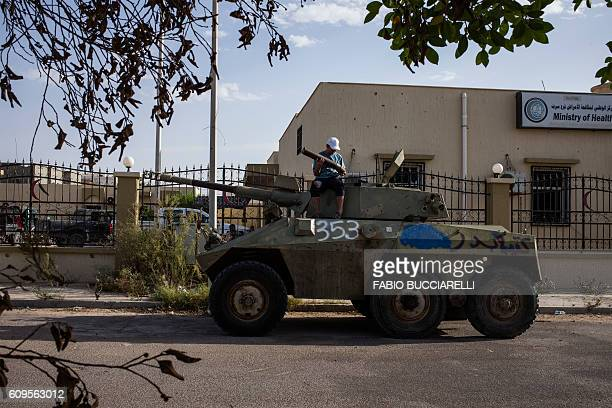A young fighter is pictured on a tank near his headquarters in Sirte Libya on September 21 2016 The forces of AlBonyan AlMarsous operation affiliated...