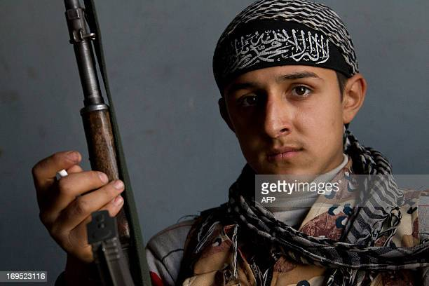 A young fighter of the jihadist group AlNusra Front poses with a weapon on April 2 2013 in the northern Syrian city of Aleppo AFP PHOTO / GUILLAUME...