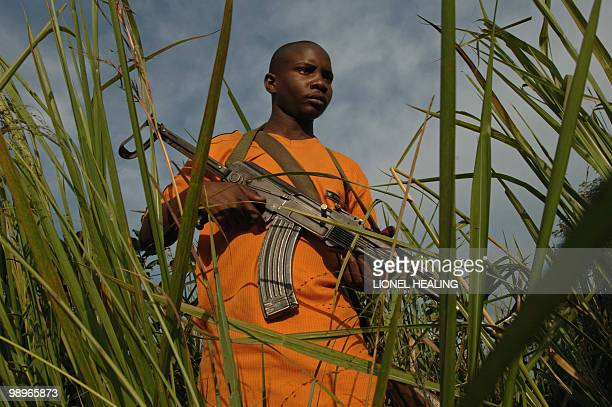 Young fighters of the FRPI militia appears from the bush 26 July 2006 5km from Tchei south Ituri The UN facilitating negotiations for possible...