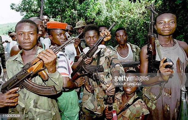 Young fighters of the Revolutionary United Front the former rebel movement now allied to the ruling junta in Sierra Leone show their weapons with a...