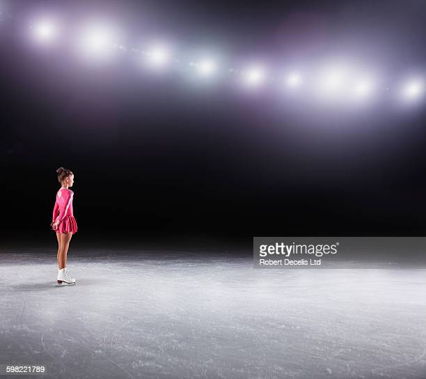 Young figure skater about to perform