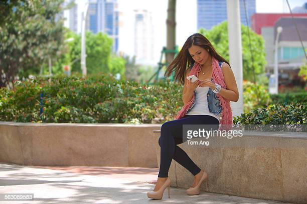 young filipina woman in makati business district - makati stock photos and pictures
