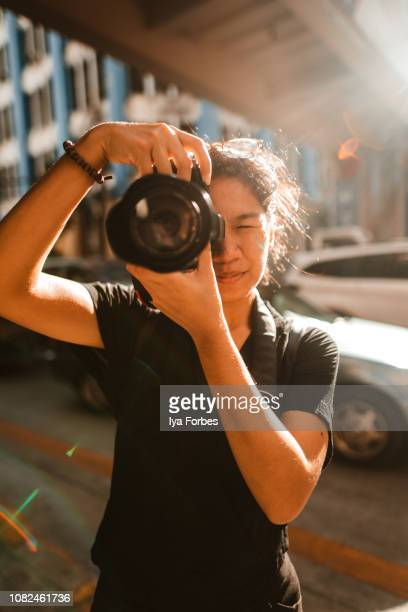 young filipino student photojournalist taking photographs - filipino culture stock pictures, royalty-free photos & images