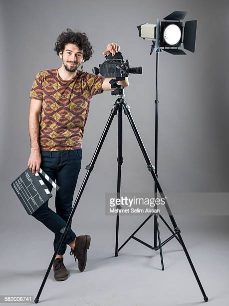 young film director posing with cinema equipments - film director stock pictures, royalty-free photos & images